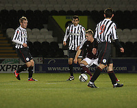 Billy King surrounded by (l to r) Jordan Holt, Mo Yaqub and Anton Bradyin the St Mirren v Heart of Midlothian Clydesdale Bank Scottish Premier League U20 match played at St Mirren Park, Paisley on 6.11.12.