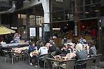 People eating outside, Brick Lane, London, E1, England