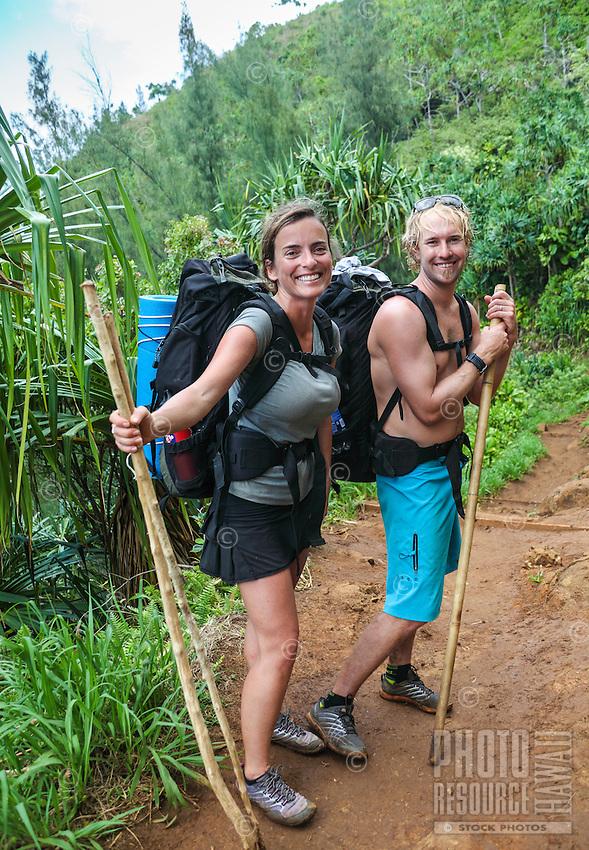 Backpackers on their honeymoon hike the Kalalau Trail on Kaua'i.