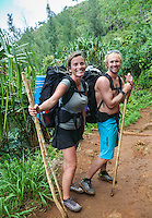 Backpackers on their honeymoon hike the Kalalau Trail on Kaua'i.