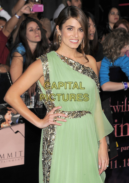 Nikki Reed.The Los Angeles premiere of 'The Twilight Saga Breaking Dawn Part 1' at Nokia Theatre at L.A. Live in Los Angeles, California, USA..November 14th, 2011.half length dress hand on hip off the shoulder green silver gold sequins sequined beads beaded earrings.CAP/RKE/DVS.©DVS/RockinExposures/Capital Pictures.