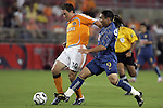 25 July 2007:  Richard Mulrooney (30) of the Dynamo battles Salvador Cabanas (9) of Club America for a loose ball.  Club America was defeated by the Houston Dynamo 0-1 at Robertson Stadium in Houston, Texas, in a first round SuperLiga 2007 match.