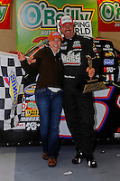 24-25 April, 2009, Kansas City, Kansas, USA.Winner Mike Skinner in Victory Lane with wife Angie. Toyota hat..©F. Peirce Williams 2009 USA.F. Peirce Williams.photography