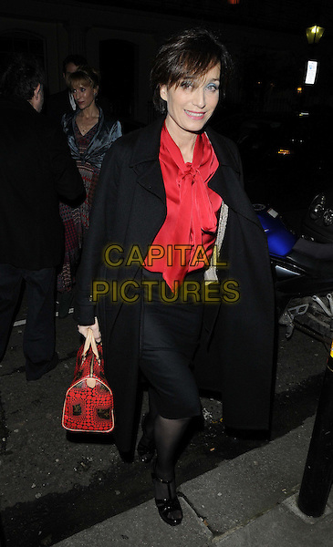 Kristin Scott Thomas.attended the press night performance of 'Old Times' Harold Pinter Theatre, Panton St., London, England, UK, .January 31st 2013..full length black coat red bag shirt pussybow pussy bow  sandals  skirt blouse blue eyeshadow smiling walking .CAP/CAN.©Can Nguyen/Capital Pictures.