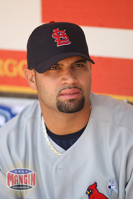 OAKLAND, CA - June 17:  Albert Pujols of the St. Louis Cardinals gets ready in the dugout before the game against the Oakland Athletics at the McAfee Coliseum in Oakland, California on June 17, 2007.  The Cardinals defeated the Athletics 10-6.  Photo by Brad Mangin