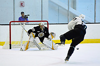 June 26, 2018: Boston Bruins forward Jack Studnicka (68) shoots on goalie Dan Vladar (80) skates during the Boston Bruins development camp held at Warrior Ice Arena in Brighton Mass. Eric Canha/CSM