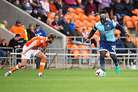 Adebayo Akinfenwa of Wycombe Wanderers brings the ball forward during the Sky Bet League 2 match between Blackpool and Wycombe Wanderers at Bloomfield Road, Blackpool, England on 20 August 2016. Photo by James Williamson / PRiME Media Images.