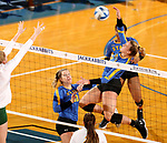 BROOKINGS, SD - OCTOBER 28: Ashlynn Smith #4 from South Dakota State looks to get a kill past the defense of North Dakota State during their match Sunday afternoon at Frost Arena in Brookings. (Photo by Dave Eggen/Inertia)