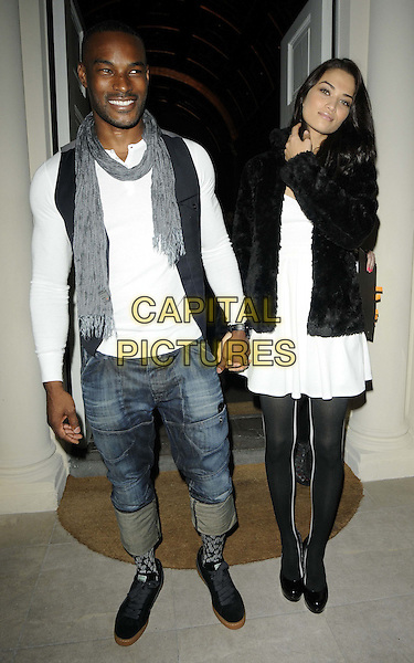 Tyson Beckford & his girlfriend Shanina Shaik.The Risque Buiness by Emilio Cavallini party, The Gallery at Sketch,  Conduit St., London, England..March 21st, 2012.full length black white jeans denim rolled turned up grey gray scarf couple dress fur jacket tights holding hands.CAP/CAN.©Can Nguyen/Capital Pictures.