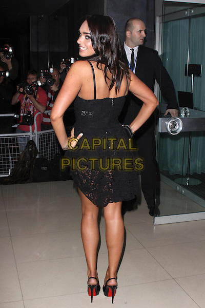 TAMARA ECCLESTONE.'An Evening At Sanderson' at The Sanderson Hotel, London, England..April 27th 2010.full length black crochet dress clutch bag platform patent shoes hand on hip back behind rear looking over shoulder profile .CAP/AH.©Adam Houghton/Capital Pictures.