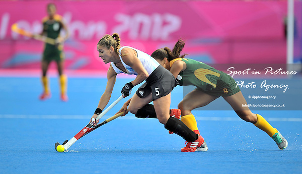 Macarena Rodriguez Perez (Argentina, 5) and Marsha Marescia (South Africa). ARG Vs RSA. Womens Hockey - PHOTO: Mandatory by-line: Garry Bowden/SIP/Pinnacle - Photo Agency UK Tel: +44(0)1363 881025 - Mobile:0797 1270 681 - VAT Reg No: 768 6958 48 - 29/07/2012 - 2012 Olympics - River Bank Arena, London, England.