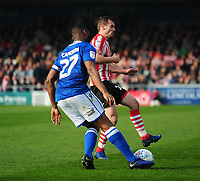 Macclesfield Town's Nathan Cameron clears under pressure from Lincoln City's Harry Toffolo<br /> <br /> Photographer Andrew Vaughan/CameraSport<br /> <br /> The EFL Sky Bet League Two - Lincoln City v Macclesfield Town - Saturday 30th March 2019 - Sincil Bank - Lincoln<br /> <br /> World Copyright © 2019 CameraSport. All rights reserved. 43 Linden Ave. Countesthorpe. Leicester. England. LE8 5PG - Tel: +44 (0) 116 277 4147 - admin@camerasport.com - www.camerasport.com