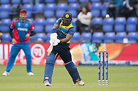 Kusal Perera (Sri Lanka) clubs the ball over extra cover for four  during Afghanistan vs Sri Lanka, ICC World Cup Cricket at Sophia Gardens Cardiff on 4th June 2019