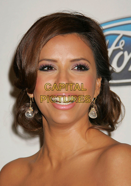 EVA LONGORIA.Press conference for the 2006 American Latino Media Arts Awards held at the Peninsula Hotel, Beverly Hills, California, USA, 04 April 2006..portrait headshot pink strapless satin lace dress.Ref: ADM/RE.www.capitalpictures.com.sales@capitalpictures.com.©Russ Elliot/AdMedia/Capital Pictures.