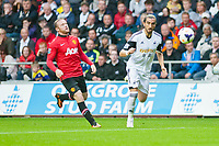 Saturday 17 August 2013<br /> <br /> Pictured: Wayne Rooney of Manchester United chases Chico of Swanea City <br /> <br /> Re: Barclays Premier League Swansea City v Manchester United at the Liberty Stadium, Swansea, Wales