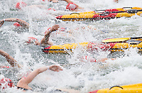 28 JUL 2013 - LONDON, GBR - Competitors start their swim during the Elite Women's race in the 2013 Virgin Active London Triathlon at Excel, Royal Victoria Dock in London, Great Britain (PHOTO COPYRIGHT © 2013 NIGEL FARROW, ALL RIGHTS RESERVED)