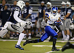 San Jose State's Hansell Wilson (87) runs past Nevada's Bryan Lane Jr. (25) during the first half of an NCAA college football game in Reno, Nev., on Saturday, Nov. 16, 2013.<br /> (AP Photo/ Cathleen Allison).