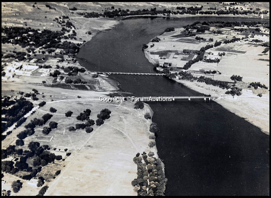 BNPS.co.uk (01202 558833)<br /> Pic: ForumAuctions/BNPS<br /> <br /> The Nowshera bridges.<br /> <br /> Stunning aerial photos taken by an RAF pilot who was based in northern India in the 1930s have come to light.<br /> <br /> The album of 52 photos of the North West Frontier, which today is part of modern day Pakistan, includes breathtaking snaps of the Khyber Pass and the Himalayas at 21,000ft.<br /> <br /> The pilot, who is pictured in the album and called himself 'Nuncs', also took an interest in the native population.<br /> <br /> There are snaps of a snake charmer entertaining the masses, while a father and son can be seen paddling in a traditional round basket boat on a river.