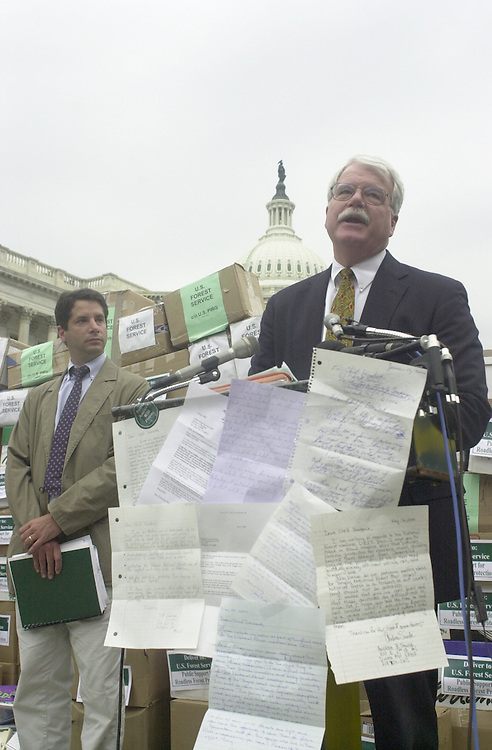 Miller.2(TW)071100--Rep. Maurice Hinchey, along side Ken Rait Director of he Heritage Forest Campaign, speaks in front of 500,000 public letters calling for the end of all road construction and logging in our nations wild forests