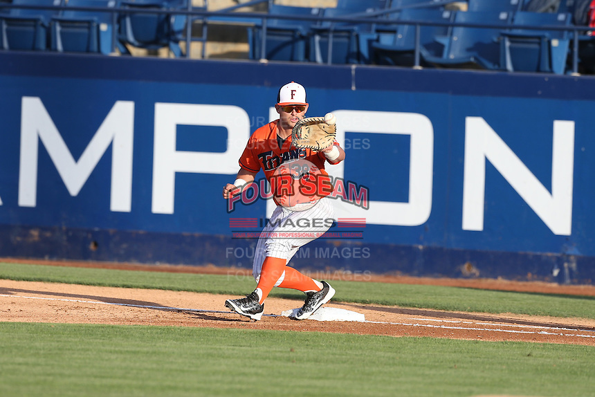 Josh Estill (38) of the Cal State Fullerton Titans takes a throw at first base during a game against the Cal Poly Mustangs at Goodwin Field on April 2, 2015 in Fullerton, California. Cal Poly defeated Cal State Fullerton, 5-0. (Larry Goren/Four Seam Images)