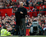 Josep Guardiola manager of Manchester City takes off his scarf during the Premier League match at Old Trafford, Manchester. Picture date: 8th March 2020. Picture credit should read: Darren Staples/Sportimage
