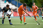 GER - Mannheim, Germany, May 16: During the whitsun tournament boys hockey match between Germany (black) and The Netherlands (orange) on May 16, 2016 at Mannheimer HC in Mannheim, Germany. Final score 4-3 (HT 2-0). (Photo by Dirk Markgraf / www.265-images.com) *** Local caption *** Brent van Bijnen #11 of The Netherlands, Benedikt Schwarzhaupt #30 of Germany (U16)