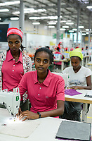 ETHIOPIA , Southern Nations, Hawassa or Awasa, Hawassa Industrial Park, chinese-built for the ethiopian government to attract foreign investors with low rent and tax free to establish a textile industry and create thousands of new jobs, taiwanese company Everest Textile Co. Ltd.  / AETHIOPIEN, Hawassa, Industriepark, gebaut durch chinesische Firmen fuer die ethiopische Regierung um die Hallen fuer Textilbetriebe von Investoren zu vermieten, taiwanesische Firma Everest Textile Co. Ltd., rechts Hana Kassa (20, und mitte Menalech Zeneb (19)