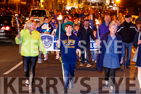 Caroline Kennedy, Samuel Behal and Maura Earley, pictured at the Remembrance of Thomas Ashe torchlight parade in Ashe Street, on Monday night last.