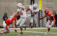 Ohio State Buckeyes running back Carlos Hyde (34) jumps past Illinois Fighting Illini linebacker Ralph Cooper (42) as Ohio State Buckeyes tight end Jeff Heuerman (86) blocks Illinois Fighting Illini linebacker Mike Svetina (34) during the second half of Saturday's NCAA Division I football game at Memorial Stadium in Champaign, Il., on November 16, 2013. Ohio State won the game 60-35. (Barbara J. Perenic/The Columbus Dispatch)