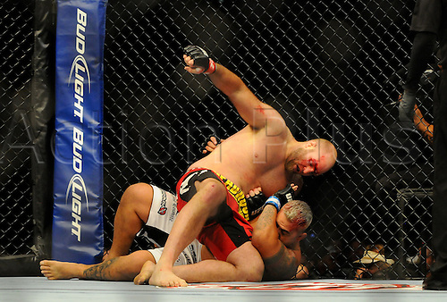24.09.2011. Denver, Colorado. Ben Rothwell throws a punch at Mark Hunt during UFC 135 at the Pepsi Center in Denver, Colorado.