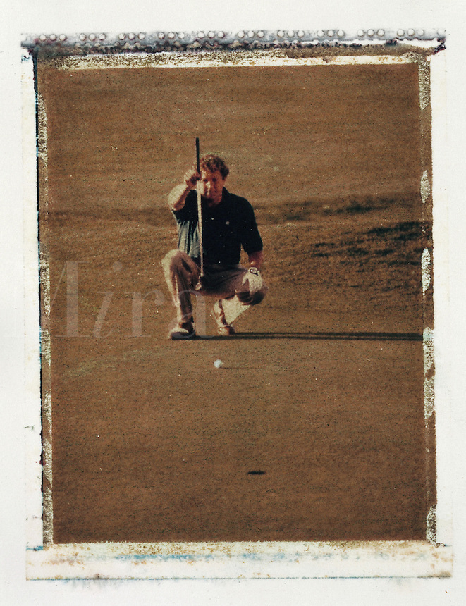 A golfer lining up a putt.