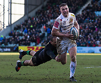 Exeter Chiefs' Joe Simmonds evades the tackle of Harlequins' Travis Ismaiel<br /> <br /> Photographer Bob Bradford/CameraSport<br /> <br /> Gallagher Premiership - Harlequins v Exeter Chiefs - Saturday 29th February 2020 - Twickenham Stoop - London<br /> <br /> World Copyright © 2020 CameraSport. All rights reserved. 43 Linden Ave. Countesthorpe. Leicester. England. LE8 5PG - Tel: +44 (0) 116 277 4147 - admin@camerasport.com - www.camerasport.com