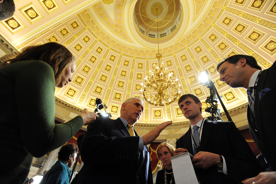 (center) Mike Pence (R-IN) House Republican Conference Chairman, answers media questions before the State of the Union address on Wed. Jan. 27, 2010. (Amanda Lucidon)