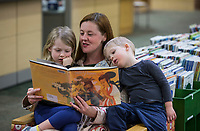 Amber Gustafson of Bentonville reads to her daughter Lulu Gustafson, 6, and son Levi Gustafson, 3 Thursday, Jan. 9, 2020, at the Bentonville Public Library.<br /> Check out nwaonline.com/200110Daily/ for today's photo gallery.<br /> (NWA Democrat-Gazette/Ben Goff)