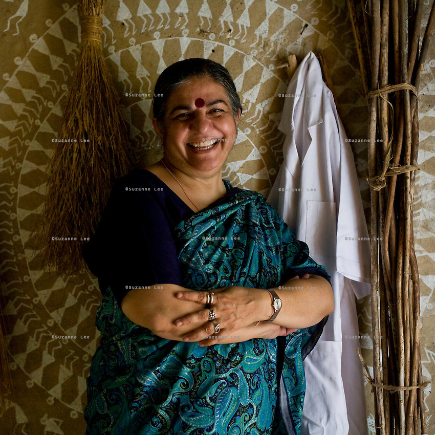 Dr. Vandana Shiva poses amongst dried crops and her laboratory coat in the Navdanya Seed bank in Dehradun, Uttarakhand, India, on 6th September 2009. The inside walls of the seed bank have all been painted by Gujarati and Rajasthani tribal artists...Dr. Vandana Shiva, the founder of Navdanya Foundation and Bijavidyapeeth, is a physicist turned environmentalist who campaigns against genetically modified food and teaches farmers to rely on indigenous farming methods.. .Photo by Suzanne Lee / For The National