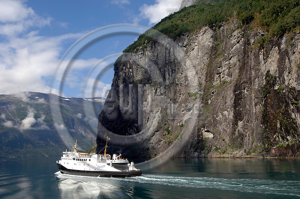 """NORWAY 3. AUGUST 2006 -- A boat on the Geirangerfjord (Geirangerfjorden) in the region Sunnmøre which is located southernmost in the county Møre og Romsdal in Norway. The fjord is a 15 kilometer long branch of Storfjord -- PHOTO: GORM K. GAARE / EUP- IMAGES..This image is delivered according to terms set out in """"Terms - Prices & Terms"""". (Please see www.eup-images.com for more details)"""