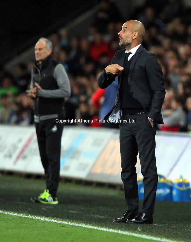 (L-R) Francesco Guidolin, manager of Swansea City nd Manager of Manchester City, Pep Guardiola during the EFL Cup Third Round match between Swansea City and Manchester City at The Liberty Stadium in Swansea, Wales, UK. Wednesday 21 September.