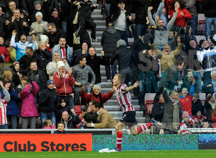 Sebastian Larsson of Sunderland AFC celebrates scoring his side's first goal during the Premier League football match between Sunderland AFC and Wigan Athletic on 26 November 2011, at Stadium of Light, Sunderland, England.
