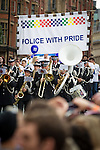 © Joel Goodman - 07973 332324 . 24 August 2013 . Manchester , UK . Police with Pride . 2013 Gay Pride Parade through Manchester City Centre . This year's theme is 1980s . Photo credit : Joel Goodman