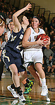 SPEARFISH, SD - DECEMBER 3, 2015 -- Remi Wientjes #10  of Black Hills State drives around Emily Vandegrift #2 of South Dakota Mines during their college basketball game Saturday at the Donald E. Young Center in Spearfish, S.D. (Photo by Dick Carlson/Inertia)