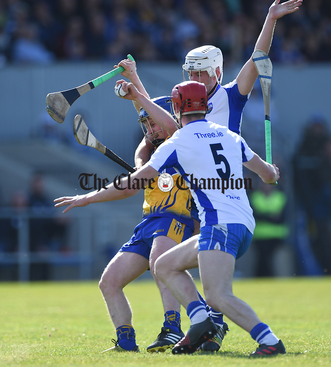 Podge Collins of Clare  in action against Shane McNulty and Tadhg de Burca of Waterford during their National League game at Cusack Park. Photograph by John Kelly.