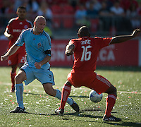 12 September 2009: Colorado Rapids forward Conor Casey #9 and Toronto FC defender Marvell Wynne #16 in action during MLS action at BMO Field Toronto in a game between Colorado Rapids and Toronto FC. .Toronto FC won 3-2..