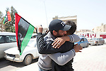 Mcc0030300 . Sunday Telegraph..Jubilant Libyans who support the revolution in the town of Ajdabiyah after Libyan government forces retreated on saturday night due to repeated attacks from NATO airstrikes...Ajdabiyah 26 March 2011