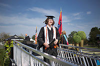 Graduate Logan Whaley walks off a platform after receiving his diploma, Friday, July 17, 2020 during a graduation ceremony at Bentonville High School in Bentonville. Check out nwaonline.com/200718Daily/ for today's photo gallery. <br /> (NWA Democrat-Gazette/Charlie Kaijo)