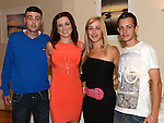 Fiona Curley pictured with friends  Eoghan Caffrey, Kecia McCash and Garreth Keegan at her going away party in the Glenside hotel. Photo:Colin Bell/pressphotos.ie