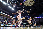 SIOUX FALLS, SD - MARCH 8: Rachel Skalnik #13 of Oral Roberts attempts a shot over South Dakota defender Ciara Duffy #24 at the 2020 Summit League Basketball Championship in Sioux Falls, SD. (Photo by Richard Carlson/Inertia)