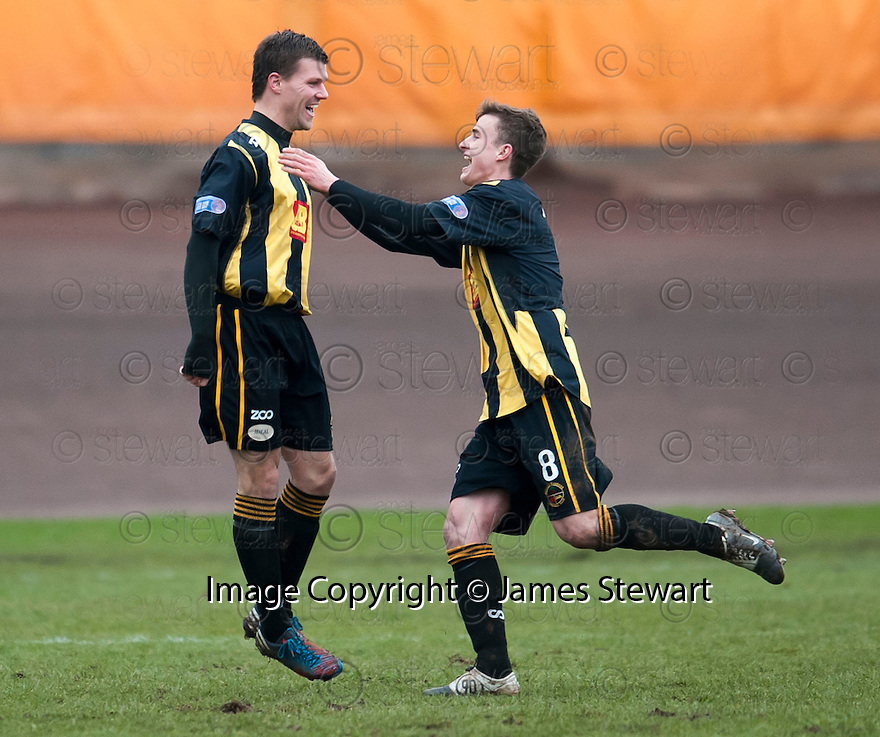 Berwick's Fraser McLaren (7) is congratulated by Steven Notman after he scores their and his second goal.