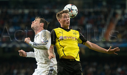 02.04.2014. Madrid, Spain.  Erik Durm (R) of Dortmund and Real Madrid's Gareth Bale vie for the ball during the UEFA Champions League quarter final first leg soccer match between Real Madrid and Borussia Dortmund at Santiago Bernabeu stadium.