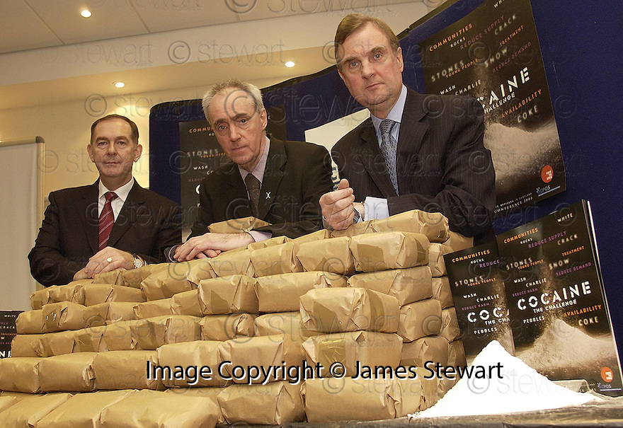 04/03/2003                   Copyright Pic : James Stewart.File Name : stewart-drugs conf 02.CENTRAL SCOTLAND CHIEF CONSTABLE ANDREW CAMERON, DEPUTY JUSTICE MINISTER HUGH HENRY AND SDEA DIRECTOR JAMES ORR WITH THE MOCK COCAINE HAUL AT THE ASSOCIATION OF CHIEF POLICE OFFICERS IN SCOTLAND'S SCOTTISH DRUGS CONFERENCE IN THE DUNBLANE HYDRO HOTEL......James Stewart Photo Agency, 19 Carronlea Drive, Falkirk. FK2 8DN      Vat Reg No. 607 6932 25.Office     : +44 (0)1324 570906     .Mobile  : +44 (0)7721 416997.Fax         :  +44 (0)1324 570906.E-mail  :  jim@jspa.co.uk.If you require further information then contact Jim Stewart on any of the numbers above.........