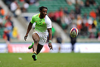 Seabelo Senatla of South Africa chips ahead during Day Two of the iRB Marriott London Sevens at Twickenham on Sunday 11th May 2014 (Photo by Rob Munro)